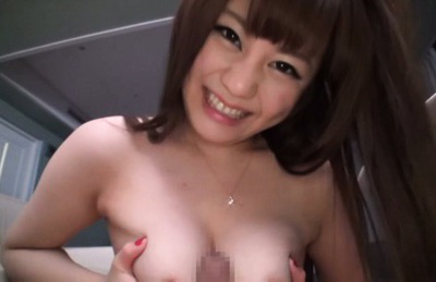 Japanese av model. Japanese AV Model cock sucking balls and rubs penis between her assets
