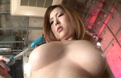 Riana Natsukawa uses a sex toy to stimulate her clit and nipples